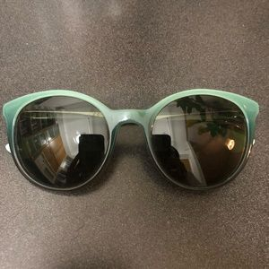teal trim Prada sunglasses